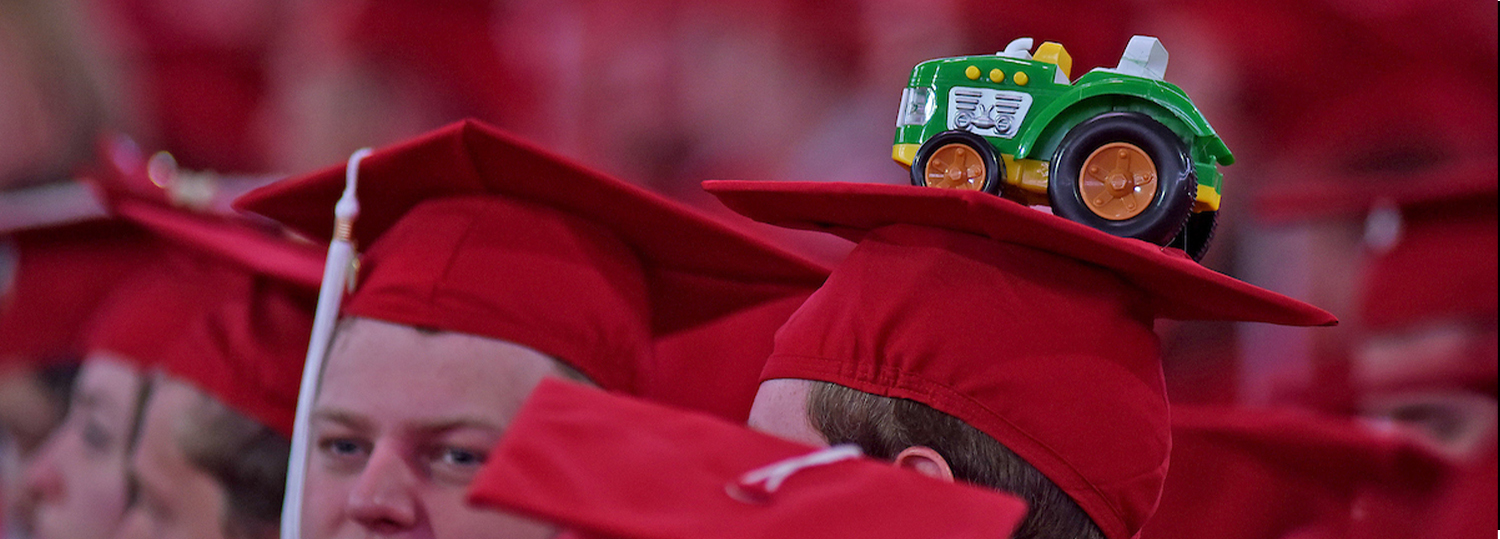 tractor on graduate mortarboard